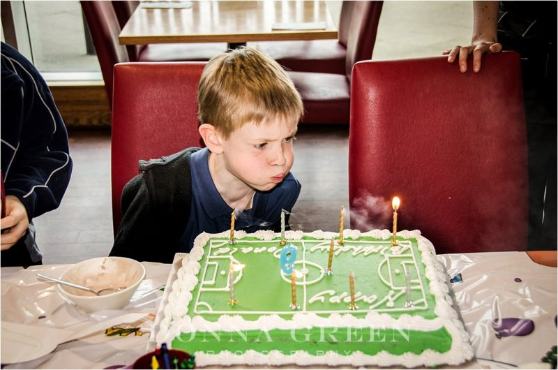 Edinburgh family photography - Little boy blowing out candles on birthday cake