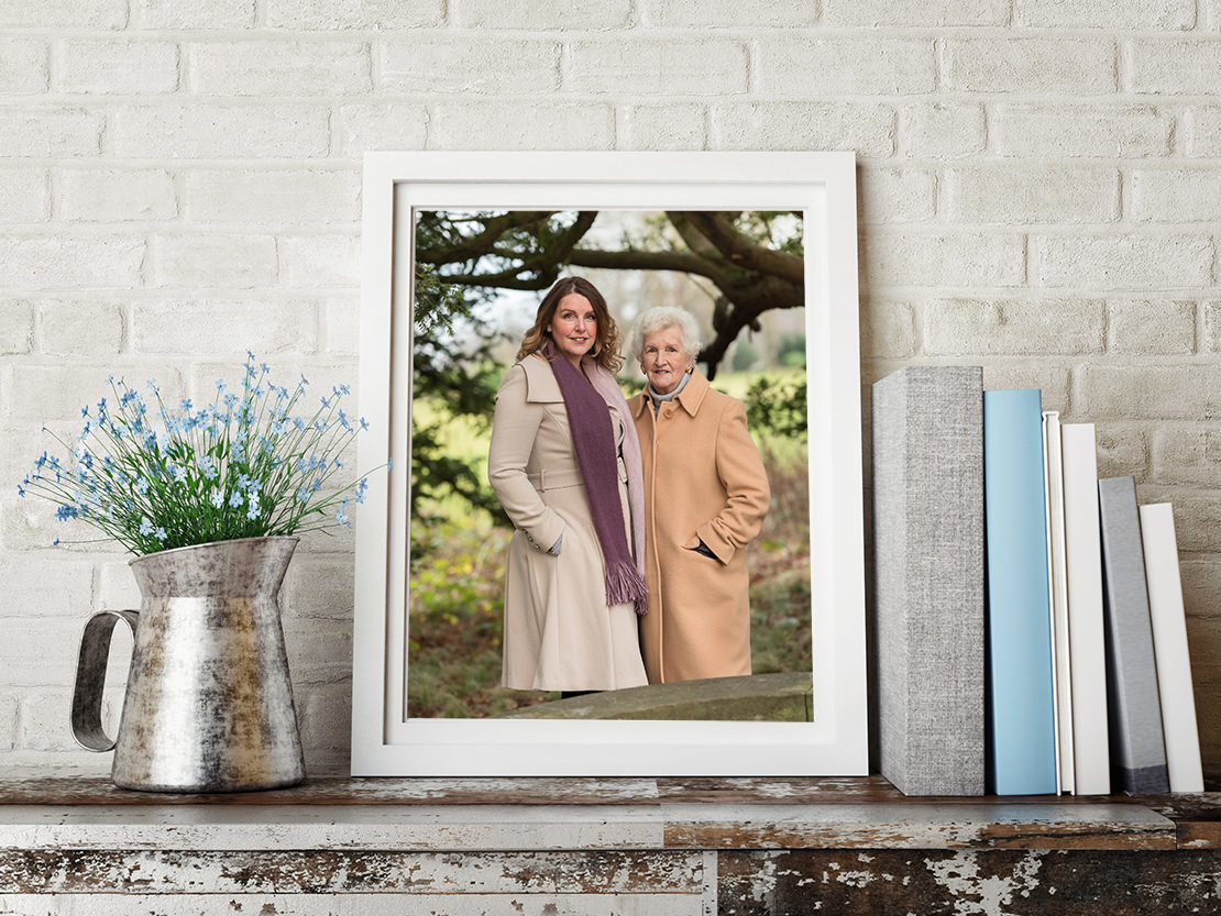 Edinburgh Portrait Photographers -  photo of mum and daughter on shelf with books and flowers