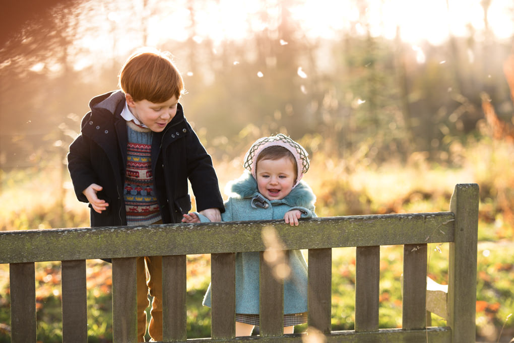 Family photographer Edinburgh - Lauriston Castle - little boy and girl on bench in autumn sun
